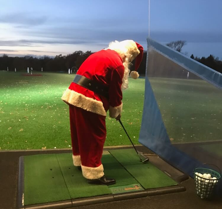 santa at the ashes-driving-range