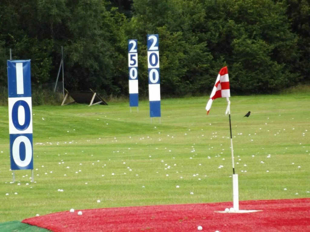 Rather than just start hitting balls, pick a target to aim for and go for it. When you play, you don't just hit a ball with no aim and hope it goes where you want so why practice that way? Not only does this give you something t focus on but it also allows you to see how successful your shots are. We have plenty or targets to pick out on the range and on occasion we've brought in some random extras from watermelons to washing machines and even a car! The idea of 'play like you practice and practice like you play' is very true and if you approach your session on the driving range like you would playing a round then it can only help your game.