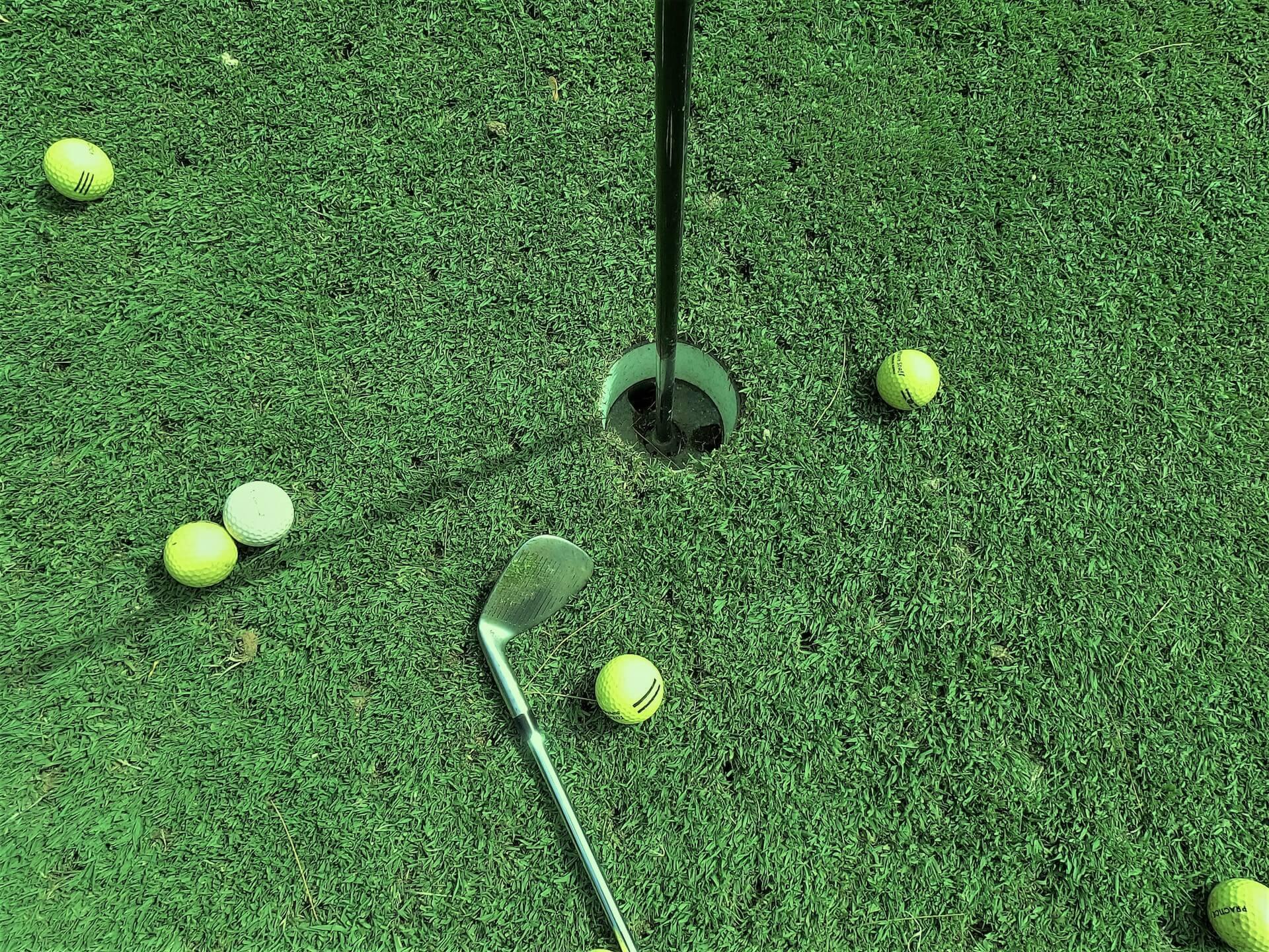 golf-hole-yellow-balls